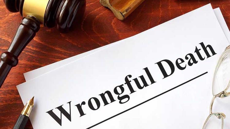 A wrongful death file on a desk.