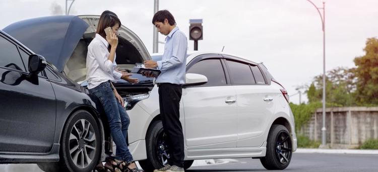 A person talking to an insurance adjuster after a car accident
